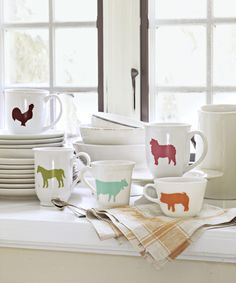 Look no further than the nearest pasture for inspiration to dress up plain dishware. To duplicate these mugs, print and cut out the animal shapes. Use these templates for Cow, Sheep, and Pig shapes. Place each shape atop a small piece of contact paper and outline it in pencil. Cut out with a craft knife; then discard the paper inside the outline. Peel away the backing and affix the stencil to a clean, dry mug, making sure to center the image. Following the package directions, use a soft…