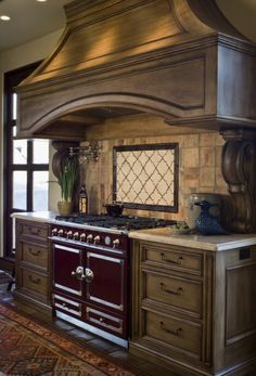 Hood design covers length of cabinets next to stove