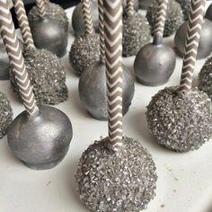 Metallic Cake Pops Displayed on Gray Chevron Paper Straws