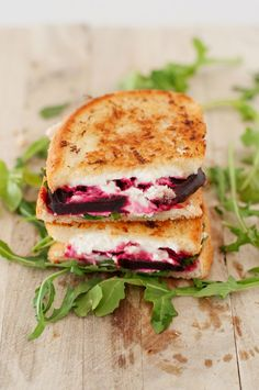 We've rounded up our favorite gourmet grilled cheese recipes, including this beet, arugula and goat grilled cheese sandwich. #Foodie #GrilledCheese