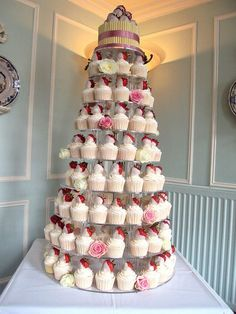 Gorgeous wedding cupcake tower with dipped strawberries #wedding #cupcakes #weddingcupcake #cupcaketower #strawberries