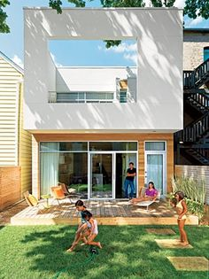 "A wall of windows makes for a nearly seamless transition from kitchen to backyard. Architect Gerardo Cerda says he designed the second-floor terrace to be ""a very private space from the inside with a sculptural look from the outside."""