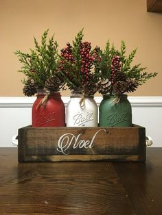 Mason Jar Chirstmas centerpiece mason jar christmas noel This is a perfect way to ring in the holiday season with this rustic Christmas centerpiece. Christmas Jars, Winter Christmas, Christmas Home, Christmas Colors, Christmas Center Piece Ideas, Simple Christmas, Apartment Christmas, Christmas 2019, Christmas Island