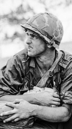 A Leatherneck consoles his wounded buddy as they await the arrival of an evacuation helicopter on Hill on May The Marines took the hill from the North Vietnamese. (By Frank Johnston, Courtesy UPI/Corbis-Bettman) Vietnam History, Vietnam War Photos, North Vietnam, Vietnam Veterans, American Soldiers, Marine Corps, Military History, Usmc, American History