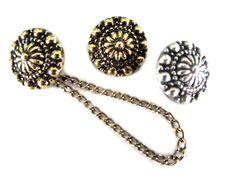 Metalen knoop met ketting