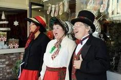 We're in the newspaper!  (The Californian) From left, Zee Labega, Kathryn Hart and Tim Hart, known as The Merry Carolers, belt out a holiday favorite.