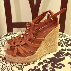 Coach brown leather wedges/espadrilles. Size 7 Beautiful brown leather strappy espadrilles by Coach. Size 7. Worn a couple times in great condition. Straps have normal signs of wear but no scuffs or rips! Soles look new. Bought at Bloomingdales for $185 in the summer were sold out by end of season! a great, super comfy sandal!! Coach Shoes Espadrilles