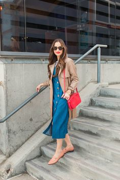 M Loves M dress outfit for a rainy day (in California) #stripedshirt #denimdress #trench #trenchcoat #redbag #crossbodybag #bag #shoes #sunglasses #layering