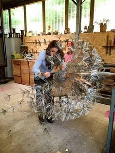 Our steel sculpture dandelions are made from stainless steel wire with copper leaves. The normal garden size dandelions stand around 6 foot highabstract sculpture made from paper mache, wire, and tree stumpTalented artist at work with wire. They bend Art En Acier, Sculptures Sur Fil, Wire Sculptures, Fantasy Wire, Sculpture Metal, Metal Garden Sculptures, Abstract Sculpture, Metal Garden Art, Deco Originale