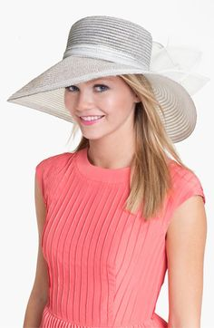 Derby style tip: Pair a romantic pink dress with a silver or gold hat