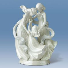There are many links between generations, but the most important bond passed down over the years is the unconditional love we share. This lustrous, hand-crafted Heirloom Porcelain® figurine celebrates the powerful connection between mothers and daughters of three generations. Encircled by a flowing shawl of soft blue, a Grandmother, her Daughter and Granddaughter embrace in a loving, happy pose. This touching figurine is hand-finished in an opalescent white glaze.