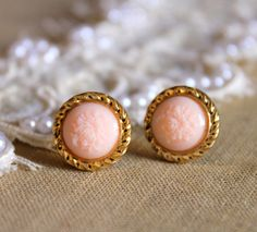 Post earrings peach rose cameo Victorian shabby chic vintage style.  These chic and elegant stud earrings feature cameo rose cabochons .  The earring is vintage, gold plated , stainless steel posts. The diameter measures 13 mm  Item will be sent in a Eco-friendly jewelry gift box , shipped within 48 hours , registered.   Thank you for stopping by! Please take a look around the shop, you might find something you like.   Made with love    Petite delights  Ilona    Join me on :