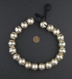 Up for sale is a beautiful strand of Ethiopian silver bicone beads. These metal beads come in an extra large size that is often difficult to find in Ethiopia. E