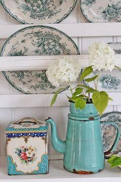 gray blue floral plates on a plate rack, old tea tin & enamel teapot with white hydrangeas
