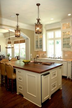 Photo - traditional - kitchen - atlanta - Keystone Millworks Inc Like the white cabinets with the paint colors. Don't like the wooden bar top.