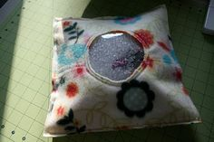 An eye spy bag.  (When I made one it was very heavy).  This looks a better size.  Good tutorial