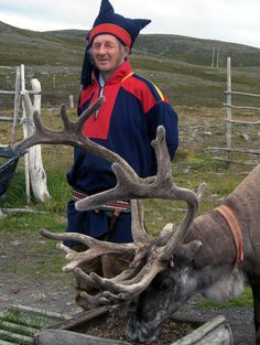 NORWAY:  Sampti: Norse Man w/ Saami Norwegian Reindeer. Only Native Saami peoples are allowed to herd the Reindeer. There still is a fair amount of Nomadic People while others settle. They dress so brightly, to this day, to be sure not to get shot -- they're so far North, that they MUST carry guns, as there are hungry Bears. For real. In the Winter, I'm not surprised!