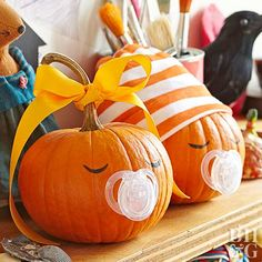 A pacifier is all it takes to create these funny pumpkin faces. Simply make a small hole and insert. Add painted or carved eyes to create the baby face.