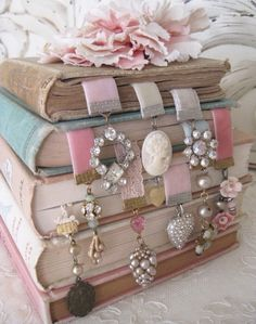 Beautiful picture of pastel books blue & pink with diy jewelry & ribbon bookmarks using the one remaining earring of lost earrings. Upcycle, Recycle, Salvage, diy, thrift, flea, repurpose, refashion!  For vintage ideas and goods shop at Estate ReSale & ReDesign, Bonita Springs, FL