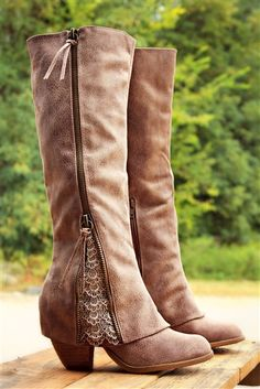 Our Sassy Classy Riding Boots in Taupe are ADORABLE!They are a synthetic leather on the exterior with a super soft microfiber interior and double zippers. They feature detailing throughout with a 'fold over' design near the ankle with lace detailing at ed