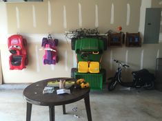 Need a place to store those bulky power wheel toys....how about the wall? So happy with how this turned out!!