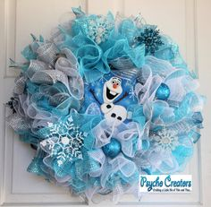 """I'm Olaf and I like warm hugs."" Your favorite snowman is sitting in a wreath of sparkly soft blues, turquoise, white and silver ruffles. The"