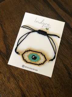 Items similar to Eye bracelet- beaded eye- mal de ojo- evil eye- GOLD-aqua- gift idea- graduation gift- birthday gift on Etsy Seed Bead Jewelry, Rose Gold Jewelry, Metal Jewelry, Beaded Jewelry, Beaded Bracelets, Handmade Wire Jewelry, Artisan Jewelry, Unique Jewelry, Evil Eye Bracelet