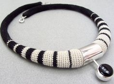 by - Linda Magi - Black and white striped necklace. Miniature crocheted cotton, silver and black onyx