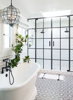 cement tile floors -- white subway with dark grout and industrial shower doors -- very chic farmhouse