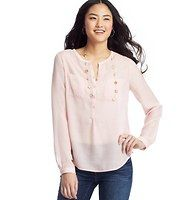 Sheer Henley Blouse - Done in light-as-a-feather silky voile – and garnished with two sweet patch pockets – this sheer henley style captures effortlessly pretty finesse. Add a cami beneath for more coverage. Split neck. Long sleeves. Henley placket with tonal buttons. Patch pockets. Button cuffs. Pleated detail beneath back yoke. Rounded hem.
