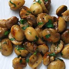 This simple yet elegant dish makes a delicious first course or, served in smaller portions, a superb amuse-gueule. - Mushrooms Sauteed with Garlic Butter