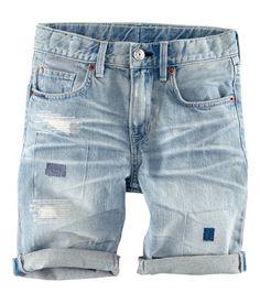 5-pocket shorts in washed denim with worn details, adjustable elasticized…