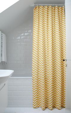 All white subway tile + yellow chevron shower curtain. Chevron Curtains, Yellow Shower Curtains, Colorful Shower Curtain, Chevron Fabric, Attic Renovation, Attic Remodel, Upstairs Bathrooms, Attic Bathroom, Attic Shower