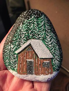 Cabin in the woods painted rock
