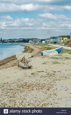 Download this stock image: Christchurch Harbour and Beach huts at Hengistbury head, Bournemouth, South of England, UK. Taken on 1st October 2015. - F4MAH7 from Alamy's library of millions of high resolution stock photos, illustrations and vectors.