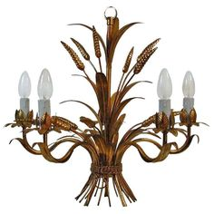 French 1950s 5 Arm Gilt Sheaf of Wheat Chandelier Hollywood Regency   From a unique collection of antique and modern chandeliers and pendants at https://www.1stdibs.com/furniture/lighting/chandeliers-pendant-lights/