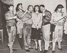 Lucille Ball & Desi Arnaz on the set of Desi's movie Bataan with his castmates, Desi looks jealous b/c his castmates are around Lucy