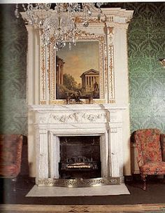 The green and black tiles behind the Georgian fireplace