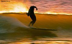 My friend Sean gliding at Sunset. By David Pu'u