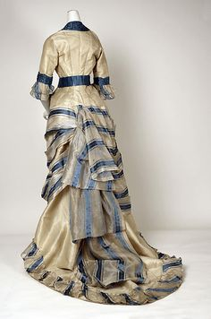 Dress, Swiss, 1880, back view.  Love how the seamstress worked with the fabric print to create interesting bustle detail in the back of this ensemble.