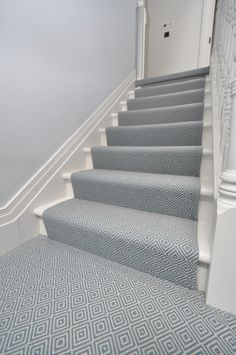 Stair runner flat weave Blue Diamond Hartley & Tissier. Seen here as a runner on a set of stairs and seamed up as a wall to wall covering on the landing. www.hartleytissier.com