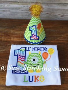 This shirt and features an adorable one eyed monster and balloons. Birthday number is included and can be changed for the birthday shirt. Fabric and thread colors can be customized. This can also be colored and styled for girls. Ruffle shirts in both long and short sleeves are