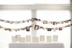 example of hanging family photos.  we string them anywhere; pathways to ceremony, porch, tent...skies the limit