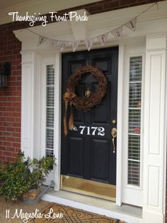"""Time to decorate the front porch for fall and Thanksgiving!  Add a neutral-colored wreath tied with a burlap bow and gather some branches from the yard or woods and display them in a rusted watering can.  A paper """"Thankful"""" banner completes the rustic look. {Sponsored by HomeGoods}"""