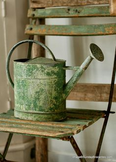 once green watering can and chair