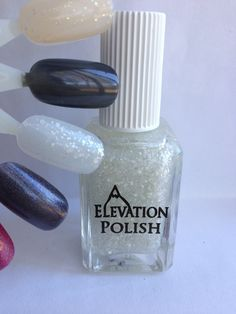 Name: Flurries  Description: Clear base with a blend of off white glitters and a hint of holographic pigment.