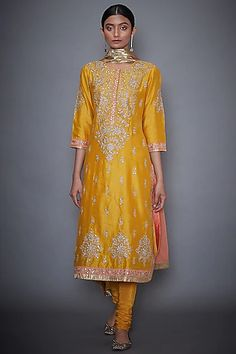 Featuring a yellow kurta in silk chanderi base with hand and machine embroidery. It is paired with matching churidar pants and a coral dupatta. FIT: Fitted at bust and waist. CARE: Professional dry clean only. Pakistani Bridal Wear, Pakistani Dresses, Celebrity Fashion Outfits, Celebrity Style, Celebrities Fashion, Ritu Kumar Suits, Chanderi Suits, Embroidered Kurti, Churidar