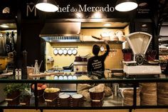 It's the Mercado de Campo de Ourique in Lisbon, and it's filled with a large variety of gourmet food stalls, mixed with thirst quenching bar...