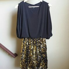 Open drape arm sequined dress Unique!  The arms are drapey and open but there is a tank inside so no unwanted exposure.  Good condition overall.  All the sequins look great! Elastic waistband. Snap Dresses