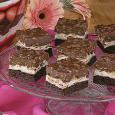 "Brownie Mallow Bars Recipe. From Lees Summit, Missouri, Stacy Butler notes, ""These yummy bars are a hit wherever I take them."" A brownie mix streamlines assembly of the chewy bars, which are topped with mini marshmallows and a decadent layer of chocolate, peanut butter and crisp cereal."